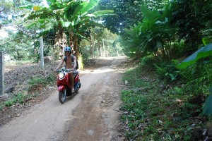 Riding mopeds in Koh Chang Thailand
