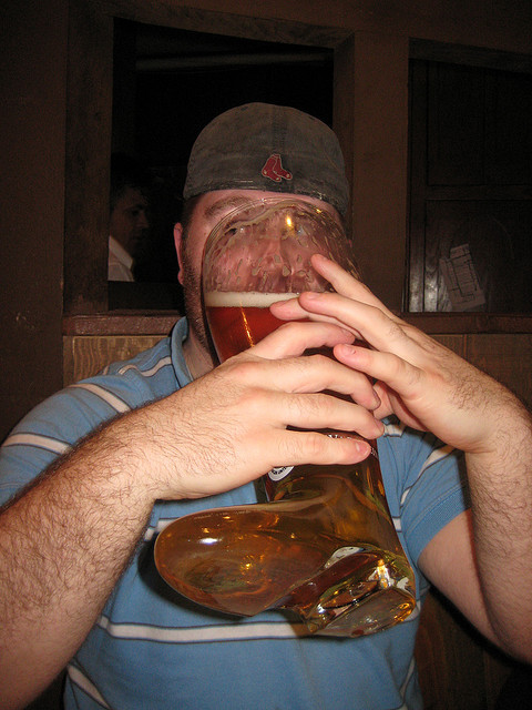 Drinking out of a beer boot